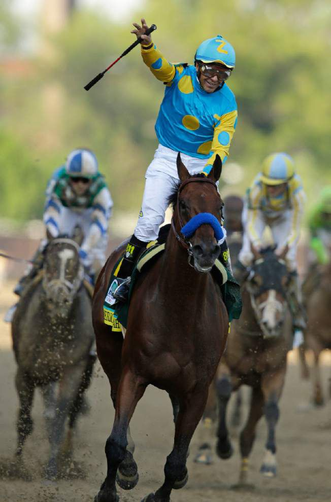 Favorite American Pharoah pulls in front down the stretch to win Kentucky Derby _lowres