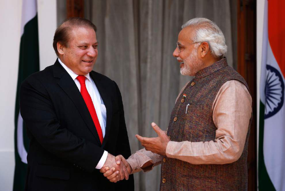 India's new PM meets with leader of rival Pakistan _lowres