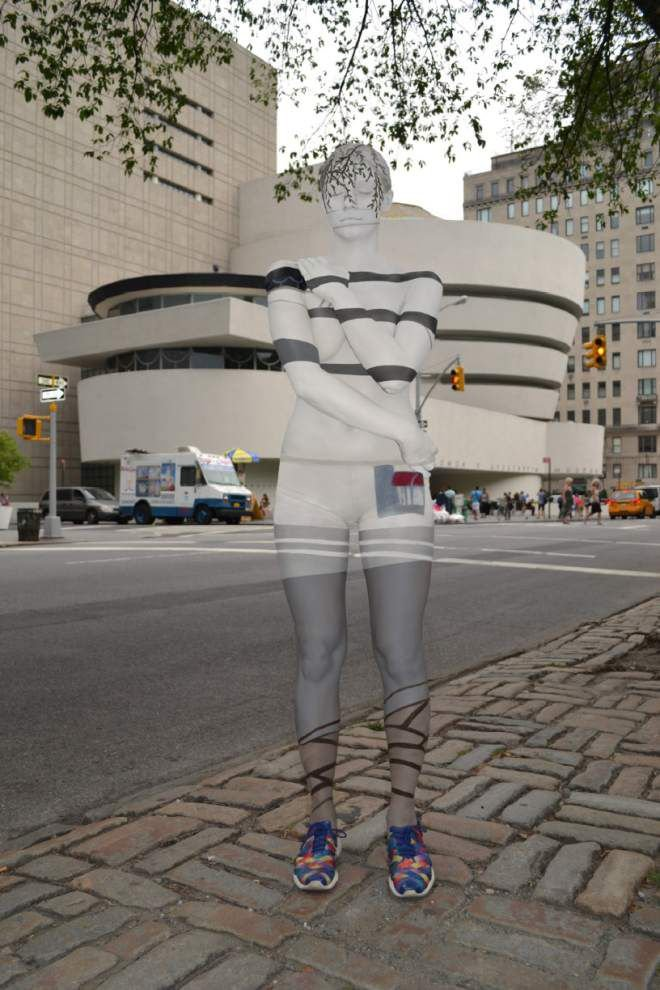 Body-paint artist blends models into NYC landmarks _lowres