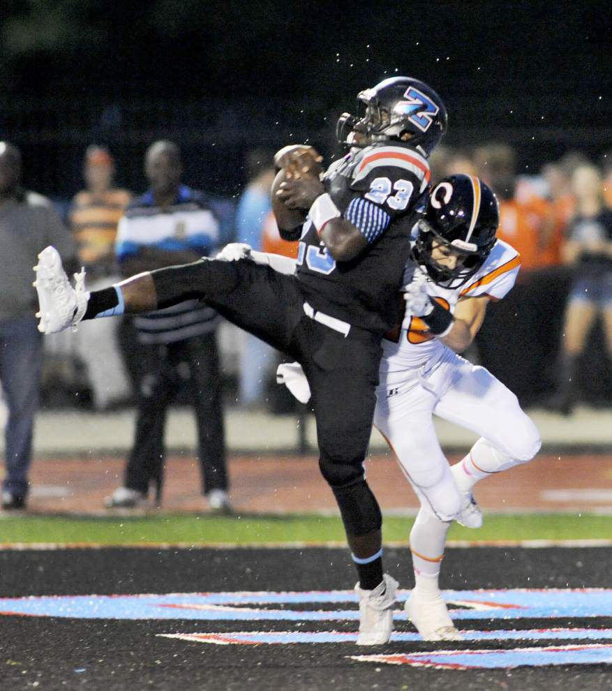 Photos: Cubs conquer Kittens; Zachary too much for Catholic High; St. Amant rolls in Week 2 _lowres