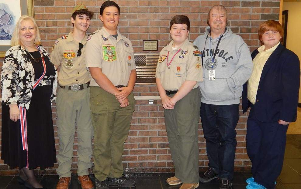 Scout donates Braille flag to veterans home _lowres