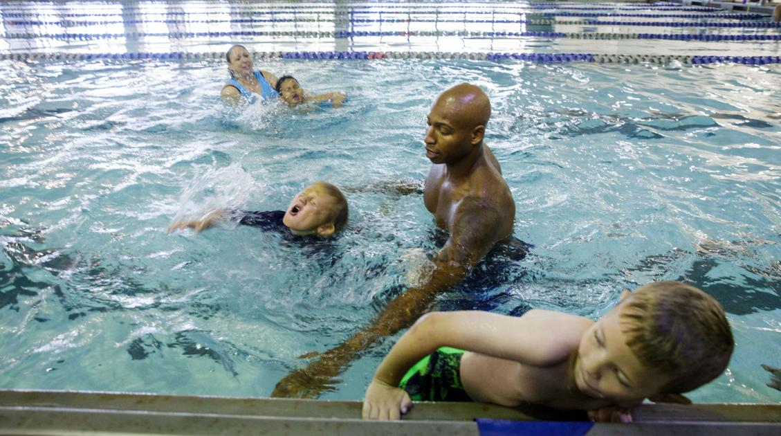 Olympic champ who nearly drowned visits New Orleans to help children avoid that experience