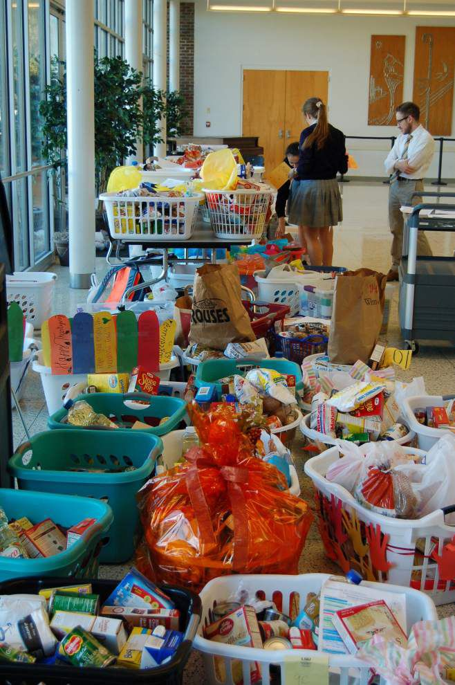 Dominican assembles Thanksgiving baskets for Gert Town families _lowres