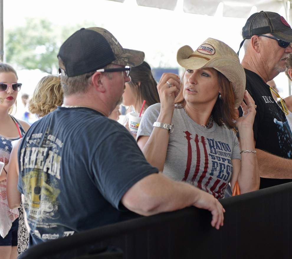 Some notice fewer people at Superfest's Fan Fest, but attendees found ways to enjoy the party _lowres