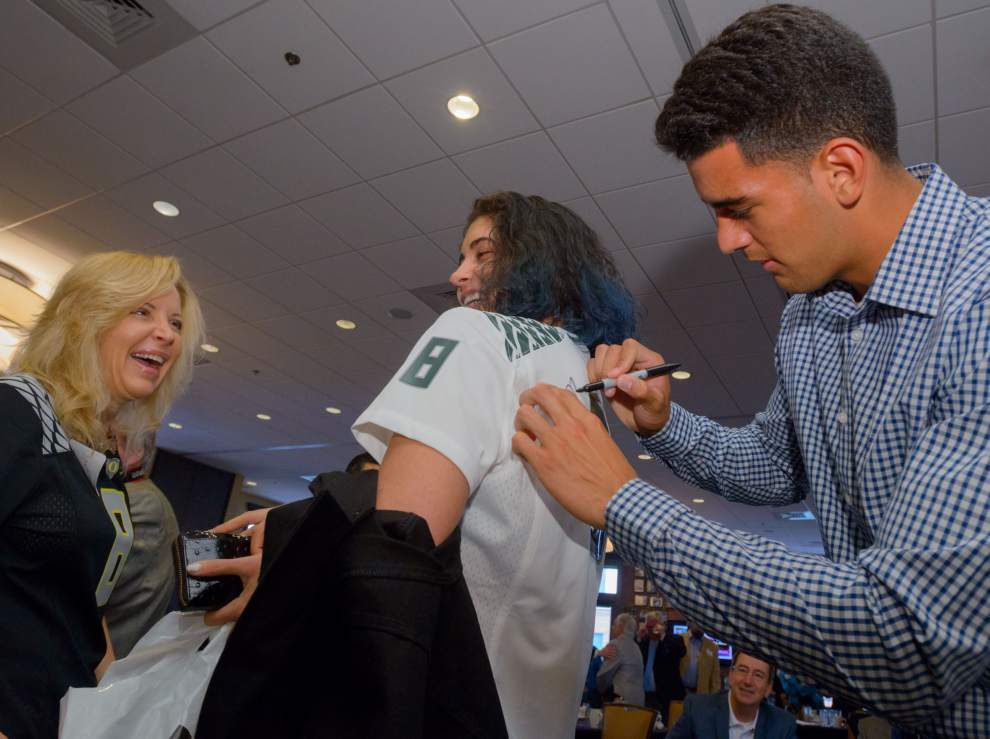 'It's all surreal' for Marcus Mariota, the Manning Award-winning QB whose NFL draft status is being hotly debated _lowres