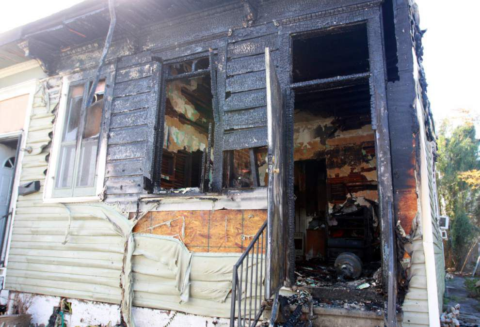 Fire guts Uptown house, displaces family _lowres