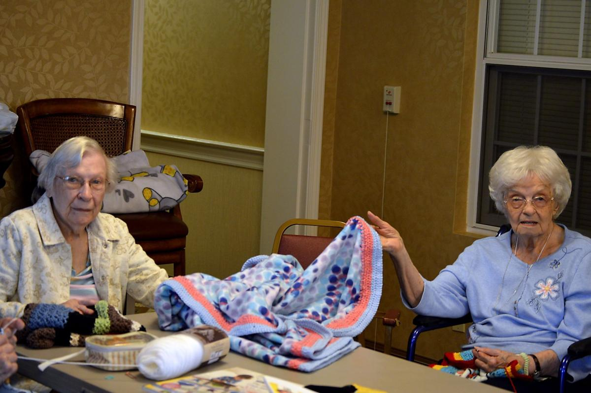 Country Meadows women knit blankets for children in hospitals