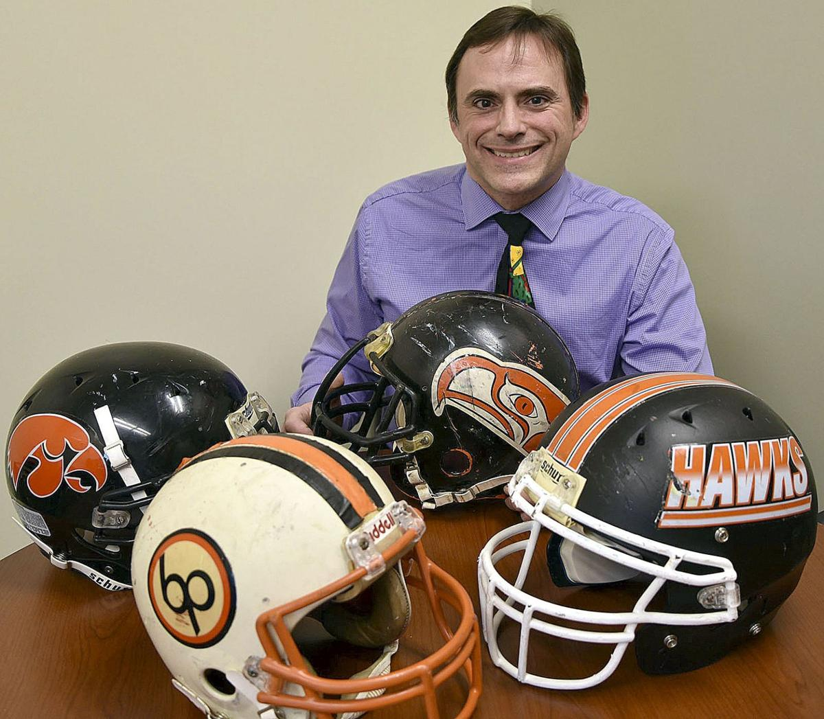 Teacher searching for classic Bethel Park football helmets to display