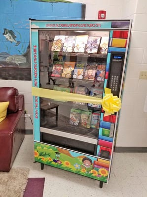 Elementary school unveils vending machine filled with ... books