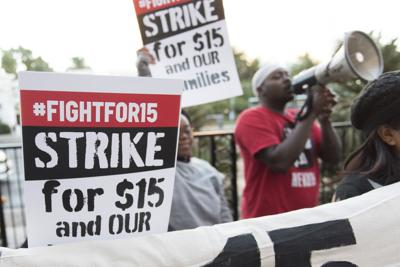 FILE - Fight for $15 minimum wage