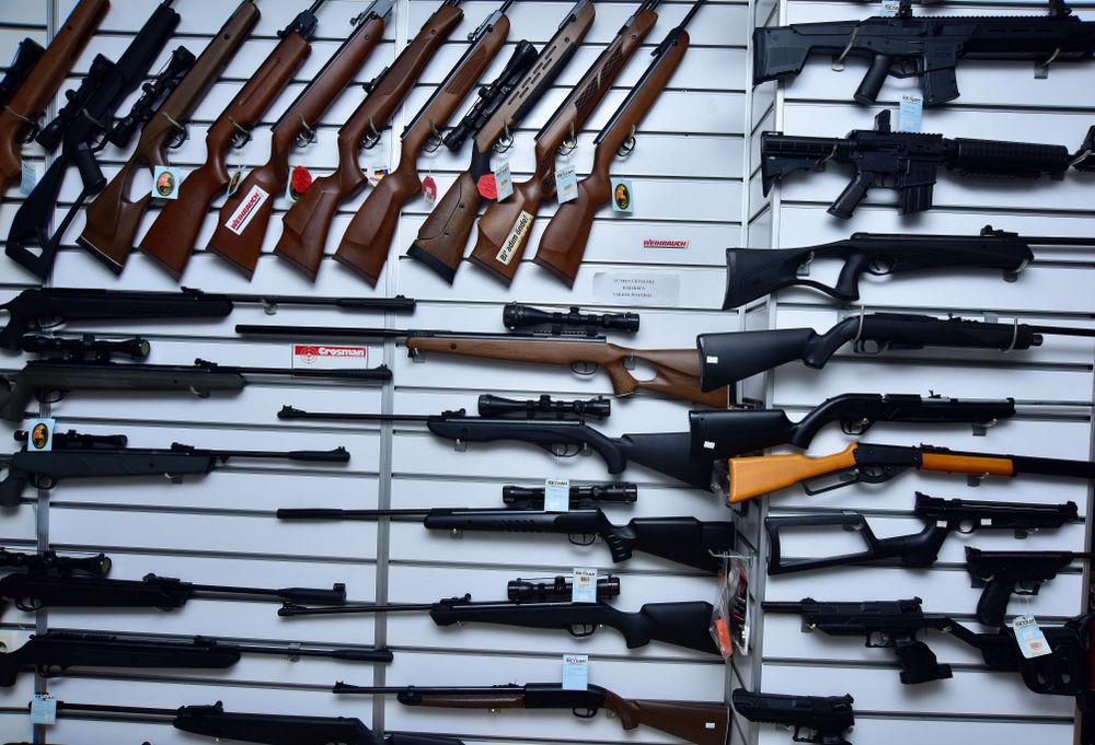 FILE - Gun show rifles weapons
