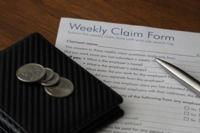 FILE - Washington weekly unemployment claim form