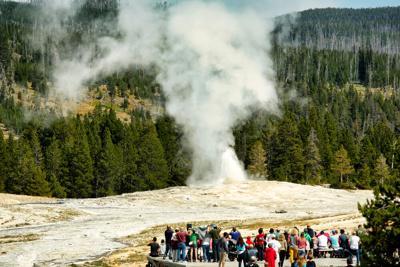 FILE - Tourists Yellowstone National Park Wyoming