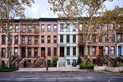 FILE - NY brownstones, apartments