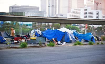 FILE - Homeless tent city California