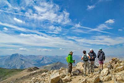FILE - Hikers in Colorado