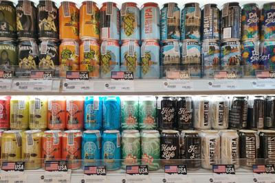 FILE - Craft beer cans