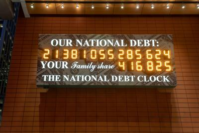 FILE - Debt clock