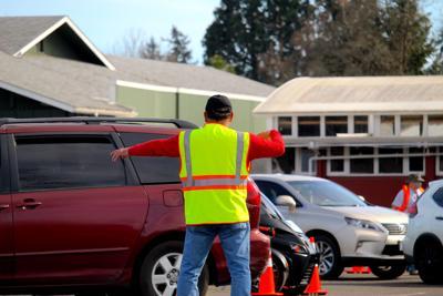 FILE —Oregon vaccine site traffic