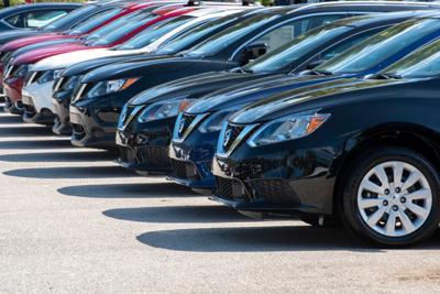 FILE - car lot, car sale dealership