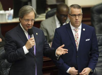 FILE - Florida state Rep. Scott Plakon and Rep. Matt Willhite