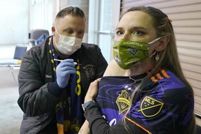 FILE —Seattle Sounders mask