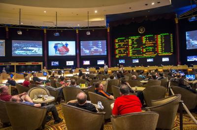 FILE - Sports betting, gambling