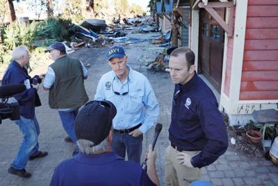 FILE - FL Gov. Rick Scott, FEMA Administrator Brock Long 10-14-18