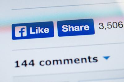 FILE - Facebook likes, shares, and comments