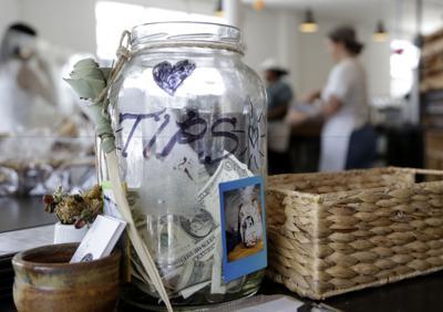 FILE - Tip jar, tips, restaurant workers