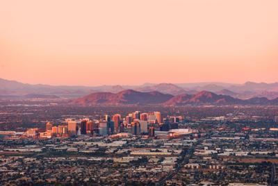 FILE - Phoenix skyline at dusk