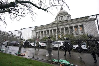 FILE — Capitol Breach Statehouses