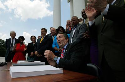 Northam Medicaid signing
