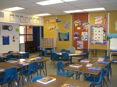 FILE - school classroom, teacher, education