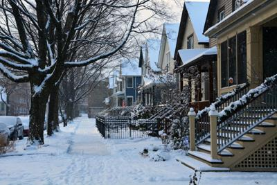FILE - Chicago neighborhood in winter, house, property taxes