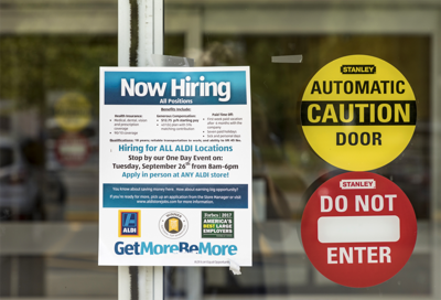 FILE - Now hiring, jobs, employment, unemployment rate