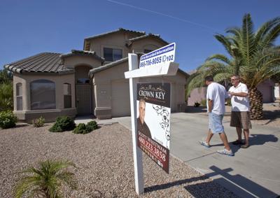 FILE - Arizona home sales