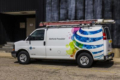 FILE - AT&T service van, ISP, broadband, internet service provider