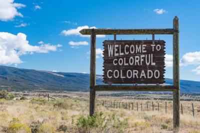 FILE - Welcome to Colorado sign
