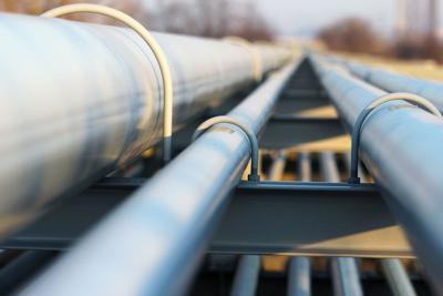 FILE - Oil refinery pipeline