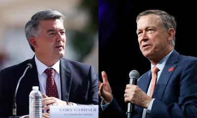 FILE - Cory Gardner, John Hickenlooper Senate Race