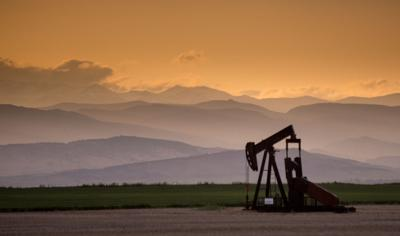 FILE - Oil pump jack in Colorado's Front Range