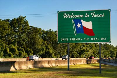 FILE - Welcome to Texas sign