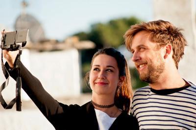 FILE - Millennials selfie