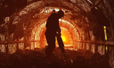 FILE - Coal miner