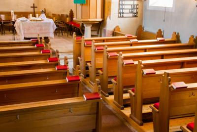 FILE – Church pews