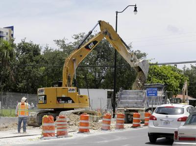 FILE - Florida road construction, road work, infrastructure