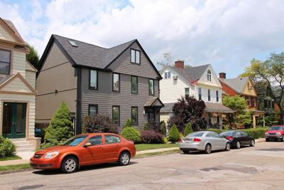 FILE - Suburban condominiums, house, property taxes