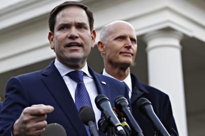 FILE - Marco Rubio and Rick Scott