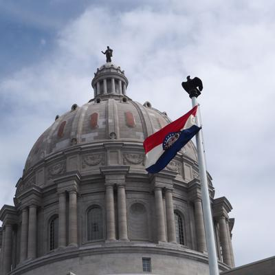FILE - Missouri state flag waves in front of capital in Jefferson City
